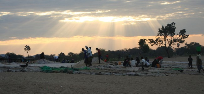 Fishermen packing up at sunset, Malawi